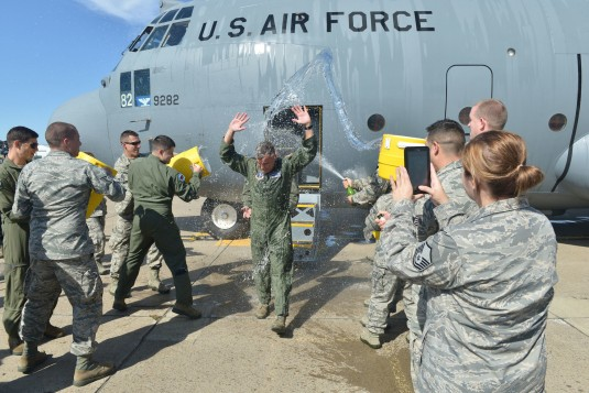 New York Air National Guard Col. John J. Higgins commander of the 107th Airlift Wing is doused by his comrades as he steps off of the aircraft following his fini flight his final flight as a navigator on Thursday, Sept 25. It was the 107th Airlift Wings f