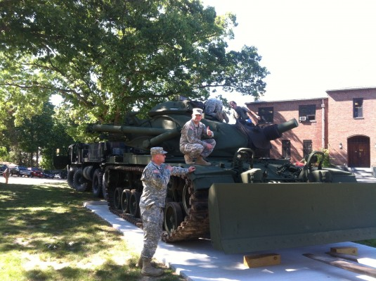 Members of the 204th Engineer Battalion install a M-728 Combat Engineer Vehicle in front of the Binghamton Armory on Sept. 24, 2014.