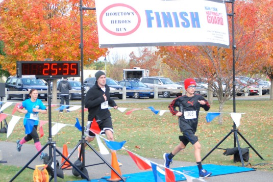 Runners cross the finish line in the 7th annual Hometown Heroes 5k Oct. 19, 2014 at the Colonie Crossings