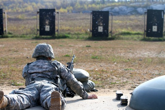 A New York Army National Guard Soldier assigned to the 42nd Infantry Division checks his targets during M-4 qualification at Fort Drum on Saturday, Oct. 25, 2014. Soldiers from the Operations and Intelligence Companies qualified on the range.