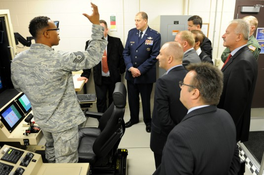 Polish defense officials get a briefing on the MQ-9 during a visit here on Wednesday, Oct. 29.New York Air National Guard leadership welcomed Poland Minister Czeslaw Mroczek.