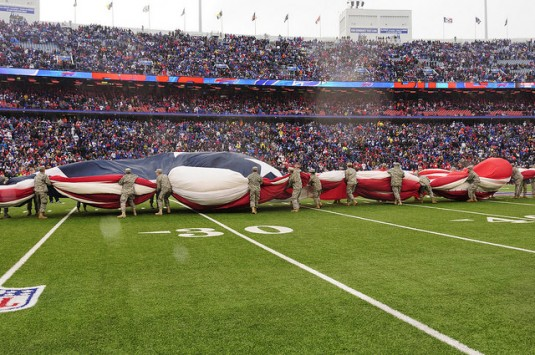 New York Army National Guard Soldiers unfurl a giant American flag to mark the opening of the football game between the Buffalo Bills and the Kansas City Chiefs on Sunday, Nov. 9. The Bills honored the New York National Guard during the game. 150 New York