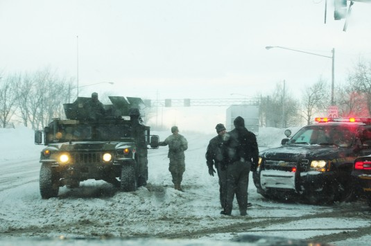 New York Army National Guard Soldiers from work with New York State Police to control access to the New York State Thruway in Buffalo, N.Y., November 20 as part of Governor Andrew Cuomo's callup of some 550 National Guard members to support respons