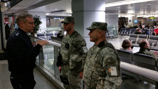 Maj. Gen. Jack Briggs, right, Director of Operations for Headquarters U.S Northern Command, visits with New York Army National Guard Soldiers on security duties