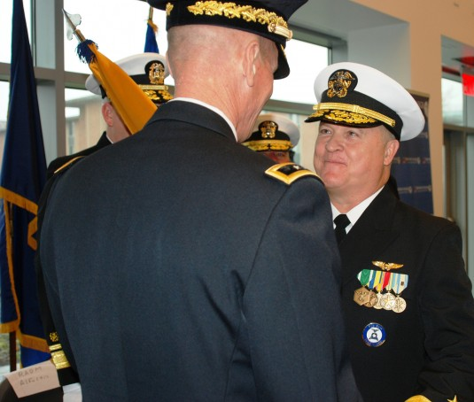 Major General Patrick Murphy the Adjutant General of New York transfers the colors of the New York Naval Militia to Naval Militia Rear Admiral Ten Eyck