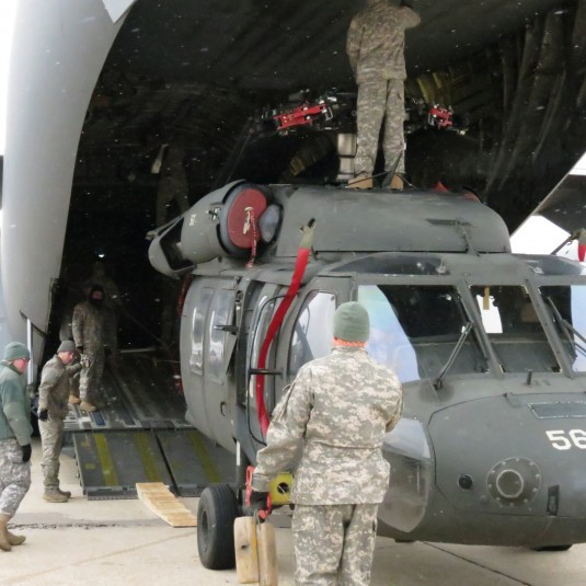 A UH-60 Blackhawk helicopter assigned to the New York Army National Guards 3rd Battalion 142nd Aviation loads onto a C-17 operated by the New York Air National Guards 105th Airlift Wing at the Army Aviation Support Facility in Ronkonkoma N.Y. on Tuesday D
