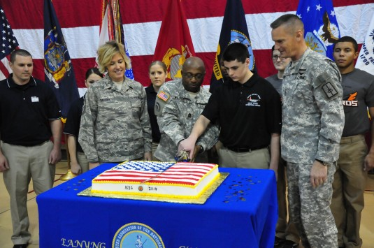 LATHAM--New York Army National Guard Command Sgt. Maj. Louis Wilson-- the senior enlisted person present-- and New York Air National Guard Airman James McPartlin, who joined the National Guard in September, cut the National Guard birthday cake during 378t
