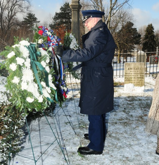New York Air National Guard Col. Kevin Rogers, the Inspector General of the 107th Airlift Wing, places a wreath from President Barak Obama on the grave of President Millard Fillmore at Forest Lawn Cemetery here on Wednesday, Jan. 7. The military tradition