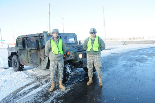 Two New York Army National Guard Soldiers from the 2nd Squadron 101st Cavalry man a traffic control point along the New York State Thruway in Cheektowaga on Friday, Jan. 9.