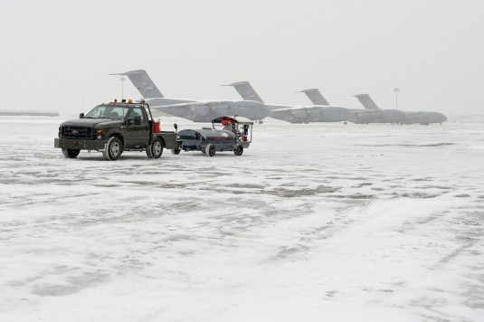 Ramp operations continue at the 105th Aiflit Wing here as snow begins to hit the Hudson Valley on Monday, Jan. 26, 2015 as the region braces for a major blizzard.