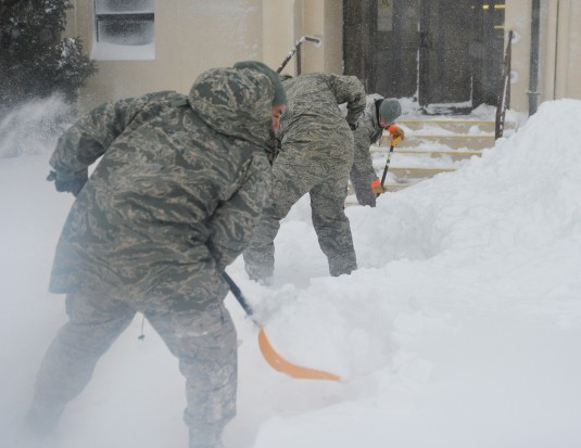 Airmen from the New York Air National Guards 106th Rescue Wing begin digging out F.S. Gabreski Air National Guard Base on Tuesday, Jan. 27 after a snow storm pummeled eastern Long Island. Members of the 106th also provided mobility support to local police
