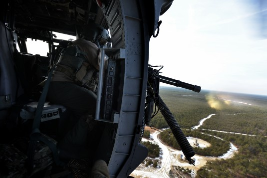 An Airman from the New York Air National Guard's 106th Rescue Wing mans the Gau-2 Mini Gunof an HH-60 Pavehawk helicopter during Combat Search and Rescue (CSAR) training 106th  at the Warren Grove Gunnery Range here on January 23, 2015.