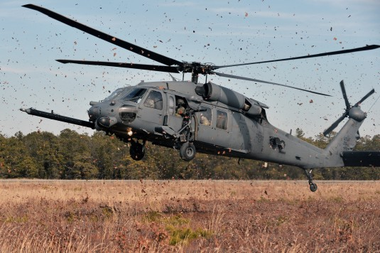 An HH-60 Pavehawk rescue helicopter assigned to the New York Air National Guard's 106th Rescue Wing flares for a landing at the Warren Grove Gunnery Range here on  January 23, 2015 during a Combat Search and Rescue (CSAR) exercise.