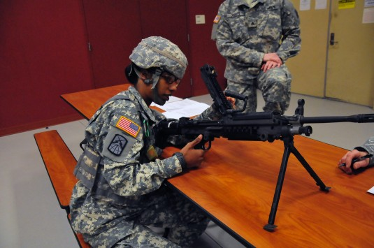 New York Army National Guard Sgt. Laila Barnes disassembles, inspects and reassembles an M249 Squad Automatic Weapon during the 42nd Infantry Division Best Warrior Competition at the Armed Forces Reserve Center in Glenville on Friday, Feb. 6.