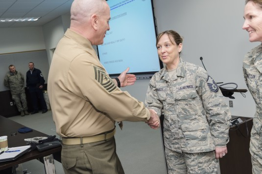 Marine Corps Sgt. Maj. Bryan Battaglia, senior enlisted advisor to the Chairman of the Joint Chiefs of Staff, congratulates New York Air National Guard Master Sergeant Kimberly Carmody, after recognizing her efforts in coordinating the Air National Guard
