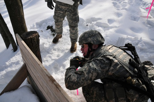 A 42nd Infantry Division Soldier prepares to throw a training grenade during basic skills training at the Camp Smith Training Site on Feb. 22. Fifty 42nd Infantry Division Soldiers are going through basic deployment training here to prepare for a deployme
