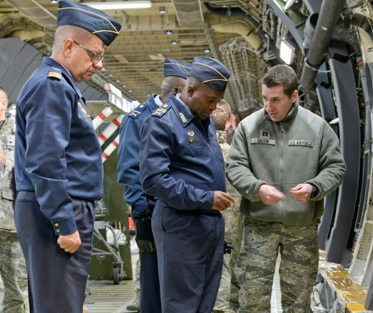 New York Air National Guard Capt. Patrick Gillen leads South African Maj Gen Wiseman Simo Mbambo on a tour of a C-5M Super Galaxy cargo bay undergoing refurbishment at the base on Monday, March 3. Mbambo visited Stewart Air National Guard Base as part of