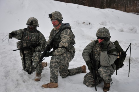 New York Army National Guard Spc. Nelson  Guzman ( left) Capt. Charles Sanders and Staff Sgt. Thomas Garbarini report enemy activity using a SALUTE report back to headquarters as part of training at Camp Smith Training Site on March 12015 .The three are