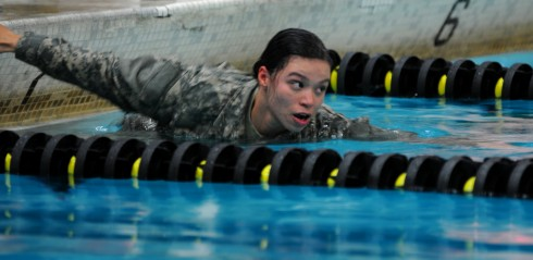 CAMP SMITH- New York Army National Guard Spc. Adilia Murillo, a military police Soldier assigned to the 107th MP Company, kicks off for the 100 m. swim in full uniform during the annual New York State Best Warrior Competition March 26, 2015, at Camp Smith