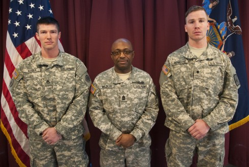 New York National Guard Command Sgt. Maj. Louis Wilson (center) poses with Spc. Michael Rowland (right) and Staff Sgt. Christian Hager (left) the winners of Soldier of the Year and NCO of the Year (respectively) after the New York Army National Guards 201