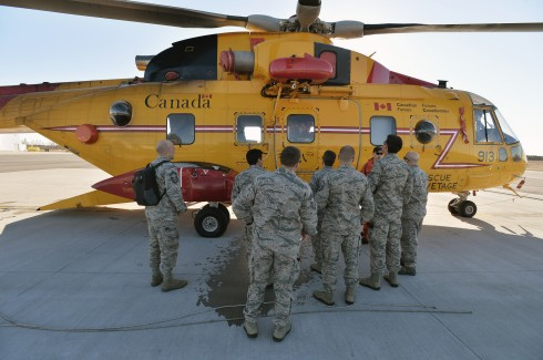 Airmen from the New York Air National Guard's 106th Rescue Wing check out a Royal Canadian Air Force CH-144 Cormorant helicopter during Operation Orange Flag 2015, a joint exercise run by the United States Coast Guard. The 106th Airmen trained with C