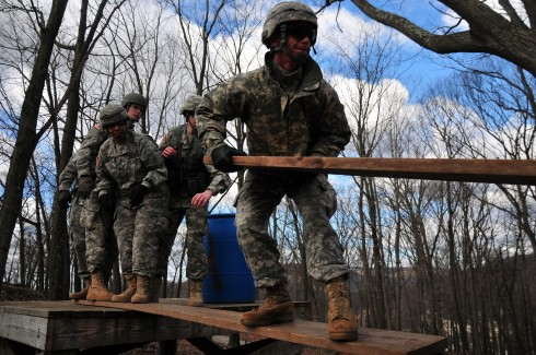 42nd Inf. Div. Soldiers from the Headquarters Services Company determine what is the best course of action to take on the Leadership Reaction Course at Camp Smith Training Site on April 11.