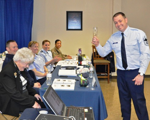 New York Air National Guard Senior Master Sgt. Harold Erickson offers a toast to Maggie Bonner, United States Air Force Protocol and Special Events Coordinator, based in S an Antonio, TX, who conducted a week-long training event on protocol for members of