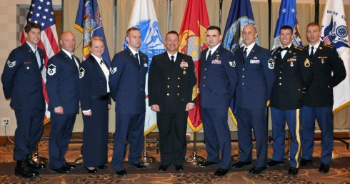 Fleet Master Chief Terrence I. Molidor, Command Senior Enlisted Leader for Headquarters, North American Aerospace Defense Command and United States Northern Command(center) poses with New York Army and Air National Guard members recognizedfor outstanding