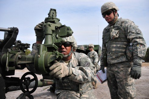 New York Army National Guard Sgt. Robert Gadsden looks throught the aiming device in order to line an initial deflection prior to a live fire excersise at Artillery Firing Point 14, Fort Dix, N.J., May 2. Gadsden and other members of the 1st Battalion 258