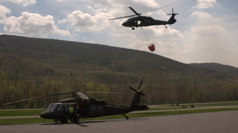 A UH-60 Blackhawk from the Army Aviation Support Facility in Latham heads out on a fire supression mission on Tuesday, May 5 while another UH-60 gets ready to go. Two UH-60 Blackhawk helicopters and crews assisted in fighting a forest fire in Shawangunk R