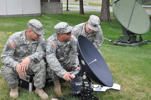 New York Army National Guard Staff Sgt. Michael Farrel,Staff Sgt. Charles Volcheck and Sgt 1st Class David Colliton adjust a satellite dish  outside Division of Military and Naval Affairs headquarters on Tuesday, May 12. Farrell, a member of the 206th Mil