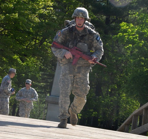 New York Army National Guard Staff Sgt. Christian Hager,a member of the 2nd Battalion 108th Infantry from Batavia, runs across the Old North Bridge here at the conclusion of the Northeast Region Best Warrior competition on May 15, 2015.