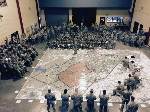 Fort Drum, N.Y. -- Members of the New York Army National Guard's 27th Infantry Brigade Combat Team conduct a rehearsal of concept briefing on a giant map of  Fort Drum as part of preparation for annual training at Fort Drum July 12 to August on May 1