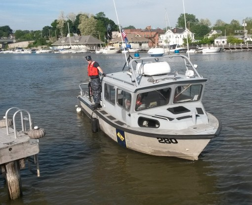 Naval Militia Patrol Boat 280 manuevers into the dock following operations on the Genessee River and Lake Ontario on Saturday, May 30.