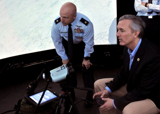 Congressman John M. Katko, representative of the 24th Congressional District in the U.S. House of Representatives, operates the Advanced Joint Terminal Attack Controller Training System (AAJTS) during his base visit Saturday, June 6, 2015. Katko spoke to