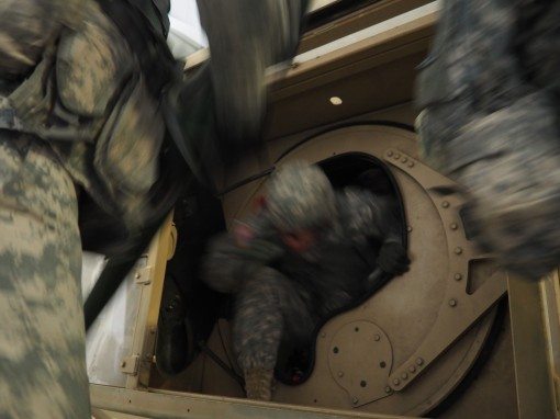 New York Army National Guard Soldiers assigned to the 42nd Infantry Division go through humvee rollover training at Fort Drum while on Annual Training.