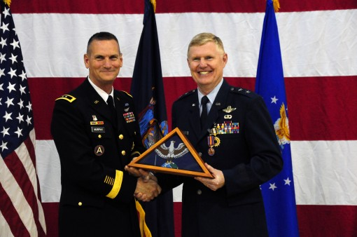 New York Air National Guard Commander, Major General Verle Johnston (right), receives a New York State Flag from Major General Patrick Murphy, the Adjutant General of New York, during a retirement ceremony for Johnston on Friday, June 12. Johnston, whose