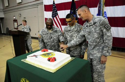 New York Army National Guard Command Sgt. Maj. Louis Wilson (left), Private Eric Dawson, a member of the 427th Brigade Support Battalion, (center) and Maj. Gen. Patrick Murphy cut the cake during ceremonies at the 240th Army Birthday, June 12 at Latham He