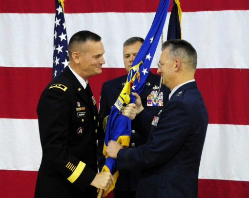 Major General Patrick Murphy the Adjutant General of New York (left) presents the flag of the New York Air National Guard to Major General Anthony German as he assumes command of the 5900-member New York Air National Guard on June 22, 2015 at New York Sta