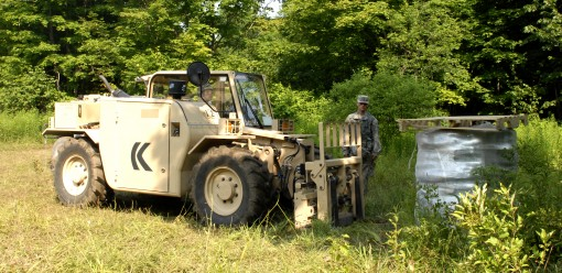 New York Army National Guard Soldiers from Company A  27th Brigade Special Troops Battalionheadquartered in Lockport NY operate an All Terrain Lifter Army System (ATLAS) to place a pallet of concertina wire during the 27th Infantry Bridge Exportable Comba