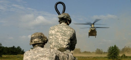 Two New York Army National Guard Soldiers from Company A, 427th Brigade Support Battalion, prepare to attach a sling-load to a CH-47 Chinook helicopter piloted by aviators from Company B, 3rd Battalion, 126th Aviation, July 19, 2015. The Soldiers, part of