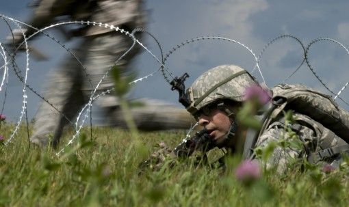 An New York Army National Guard Infantryman assigned to Company C, 1st Battalion, 69th Infantry Regiment, takes part in a platoon combat training exercise at Fort Drum, N.Y. July 23. The unit was preparing, along with the rest of the 27th IBCT, for its ro
