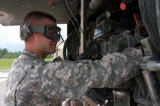New York Army National Guard Spc. Taylor Bechand, a member of Company E, 3rd Battalion 142nd Aviation, adjusts the fuel flow on a HEMTT fueler while setting up a Forward Arming and Refueling Point, or FARP, during the 42nd Combat Aviation Brigade's a