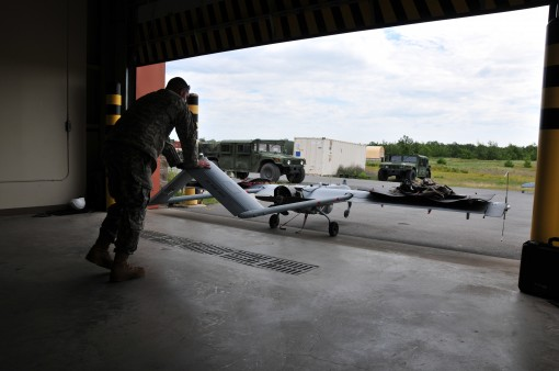 A Soldier from the 27th Infantry Brigade Combat Team's Detachment 1, Company B,27th Special Troops Battalion, prepares to launch one of seven Shadow RQ-7 UAV's during the 27th's Exportable Combat Training Capabilities annual training in pre