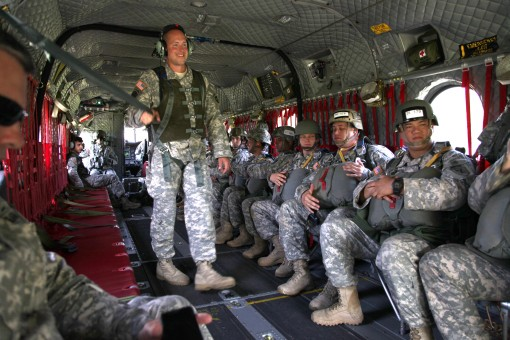 Paratroopers sit and wait on a New York Army National Guard CH-47 Chinook helicopter assigned to Company B. 3rd Battalion 126th Aviation prior to a jump at Leapfest here on Aug. 1 2015.