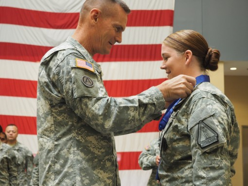 New York Army National Guard Staff Sgt. Marlana Watson receives the New York State Medal for Valor from Major General Patrick Murphy, the Adjutant General of New York, during Wednesday, August 19 ceremony at the Armed Forces Reserve Center here.