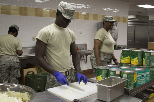 New York Army National Guard Pvt. Leloua Koffi prepares salad in the dining facility during the 369th Sustainment Brigades annual training at Fort Drum August 20 2015. The battalions annual two week training event focuses on building both the individual a