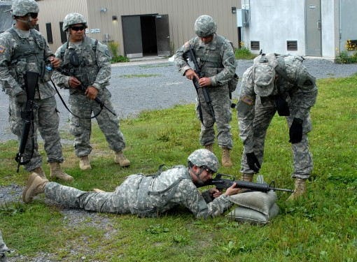 New York Army National Guard Spc. Fernando Sanchez of the 101st Signal Battalion conducts a marksmanship class on a pop-up target range at Fort Drum New York on August 24 2015. The battalions annual two week training event focuses on building both the ind