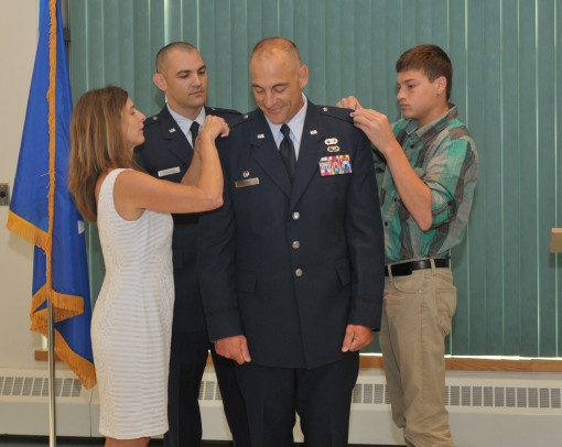 STRATTON AIR NATIONAL GUARD BASE- Newly promoted New York Air Natgional Guard Col. Jeffrey Hedges the 109th Mission Support Group commander gets pinned by his family during his promotion ceremony Aug. 18 2015 at Stratton Air National Guard Base New York.
