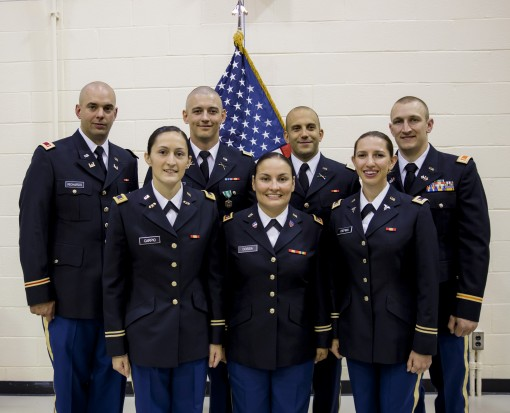 The seven newest second lieutenants in the New York Army National Guard pose for a photograph after graduating from Officer Candidate School stand together a on Aug. 15, 2015, at Camp Smith Training Site, Cortlandt Manor, N.Y.